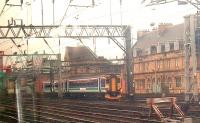 A Class 156 still in old ScotRail colours passes Bridge Street in the approach to Glasgow Central<br><br>[Graham Morgan 05/08/2006]