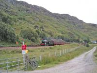 The Jacobite drops down to the crossing at Kinloid Farm between Arisaig and Morar.<br><br>[John Robin 22/08/2006]