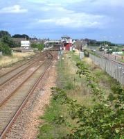 Southern approach to Carnoustie station in August 2006. The original station, replaced in 1900, was located on this side of the level crossing.<br><br>[John Furnevel 12/08/2006]