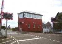 The impressive Carnoustie signal box in August 2006, looking seaward over the level crossing.<br><br>[John Furnevel 12/08/2006]
