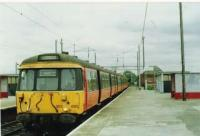 A refurbished 303 stops on a service to Balloch.<br><br>[Brian Forbes /10/1994]