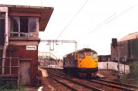 A light 26 passes Bowling box at speed. Bowling box was swept away in the Yoker resignalling. Access by kind permission of British Rail.<br><br>[Ewan Crawford //1990]