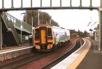Train from Glasgow Queen Street via Cumbernauld calls at Camelon, its last stop before Falkirk Grahamston.<br><br>[Brian Forbes 21/09/2006]