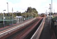 View of the modern station. The former Falkirk Camelon station, which was an island platform now overgrown, is passed by a 158 on the down line.<br><br>[Brian Forbes 23/09/2006]