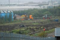 Equipment being unloaded at the former carriage sidings at Cowlairs. Note some site clearance has taken place.<br><br>[Ewan Crawford 17/10/2006]