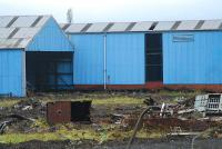 The shed at the Cowlairs Carriage Sidings viewed from the east with the remains of the train-washer in the foreground.<br><br>[Ewan Crawford 28/10/2006]