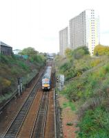 A service on the bidirectional track of the Cowlairs Incline which is overlooked by high flats.<br><br>[Ewan Crawford 04/11/2006]