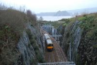 Bishopton Cutting and tunnels were cut into solid whinstone rock which delayed the opening of the line by 7 months. View looks west with a backdrop of the River Clyde and Dumbarton Castle.<br><br>[Ewan Crawford 03/01/2007]