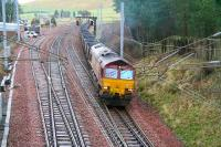 EWS 66025 brings the 1155 Chalmerston - Rugeley coal train out of the up loop at Abington and onto the WCML on 31 January 2007 having been sidelined for a passing Pendolino.<br><br>[John Furnevel 31/01/2007]