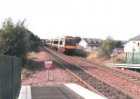A Glasgow - Grahamston service arrives at Camelon.<br><br>[Brian Forbes /09/2006]