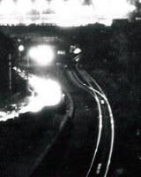 Note the distant points in this view after dark on 10/3/76. There is now double track here.<br><br>[Ken Strachan /03/1976]