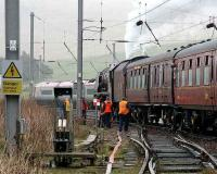 A passing Pendolino gives a long and loud salute to the stately old lady as <I>Duchess of Sutherland</I> replenishes her tender in the down loop at Abington on 9 April 2007 with the 'Great Britain' railtour.<br><br>[John Furnevel 09/04/2007]