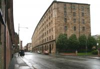 Built in the mid 1870s by the City of Glasgow Union on the site of the Old College of the University of Glasgow, the former College Goods warehouse still stands as housing on Bell Street. View west towards High Street, May 2007.<br><br>[John Furnevel 06/05/2007]