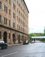 Looking east along Bell Street in May 2007, showing the former College Goods warehouse. The plate girder bridge carries the CGU line north towards High Street East Junction, with the entrance to the old Gallowgate station just off picture to the right below the bridge [see image 14887].<br><br>[John Furnevel 06/05/2007]