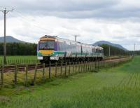 170 403 in Scotrail colours heads for Cupar, about to pass Bow Of Fife L.C. The peaks are East(L) & West(R) Lomond Hills.<br><br>[Brian Forbes 28/05/2007]