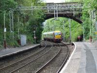 334014 approaching Cartsdyke with a service from Gourock bound for Glasgow Central<br><br>[Graham Morgan 23/05/2007]