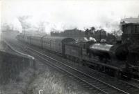 N.B. 4.4.0 62498 <i>Glen Moidart</i> banked by 0.6.2T 9148 on Polmont Train.<br><br>[G H Robin collection by courtesy of the Mitchell Library, Glasgow 20/09/1948]