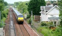 A GNER Glasgow Central - Kings Cross service passing the former station at Braidwood, South Lanarkshire (closed July 1962) on 28 June 2007.<br><br>[John Furnevel 28/06/2007]