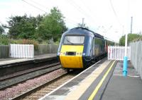 HST heads south on the ECML through Chathill on 16 August. Behind the fence on the right was a bay platform serving the North Sunderland Light Railway running to Seahouses on the coast. <br><br>[John Furnevel 16/08/2007]