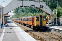 Class 314s heading for Milngavie at Bearsden in June 1997.<br><br>[David Panton /6/1997]