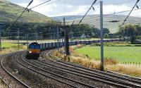 Northbound Tesco containers at Abington.<br><br>[Ewan Crawford 25/09/2007]