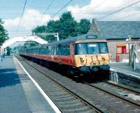 303 106 with a Glasgow train at Bishopton in June 1998.<br><br>[David Panton /6/1998]