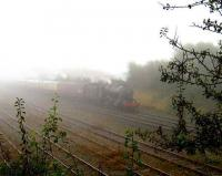 A <I>touch of fog</I> over North Lancs on 13 October as an ethereal 48151 departs Carnforth past the Virtual Quarry sidings. <br><br>[John McIntyre 13/10/2007]