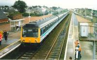 A 6-car 117 set about to head south ecs from Carnoustie during the 1999 <I>Open</I>. <br><br>[David Panton 17/07/1999]