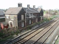 Barton and Broughton station closed in 1939 but the station building survived as a pair of houses next to the down WCML until finally demolished in the summer of 2013. Pictured from the overbridge looking north in March 2008. [See image 44079] (SD 515364)<br><br>[Mark Bartlett 01/03/2008]