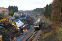 A Bathgate - Edinburgh service passes widening works near the former Bangour Junction in November 2007.<br><br>[James Young 15/11/2007]