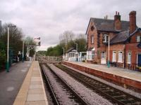 The start of the single line section from Cattal looking towards Knaresborough and Harrogate and showing the signal box, crossing and station building opened in 1848.<br><br>[Mark Bartlett 28/04/2008]