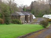 Chatburn has been closed since 1962 but the main station building survives in connection with a caravan storage park and is seen here from the approach road. <br><br>[Mark Bartlett 30/04/2008]