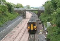 A Glasgow - Carlisle service runs east along the single line section towards Gretna shortly after leaving Annan on 21 May 2008 alongside recently laid track that will eventually form the new up line. The train is about to pass the bridge that carried the Solway Junction Railway from Annan Shawhill south to the Solway Viaduct. Nowadays the bridge is spanned by a waste-water pipeline linking the decommissioned nuclear power station at Chapelcross with the Solway Firth.     <br><br>[John Furnevel 21/05/2008]
