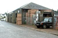 The substantial old goods shed at Castle Douglas, seen here in July 2002 put to use by a builders merchant.<br><br>[John Furnevel 15/07/2002]