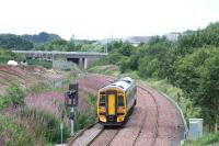 View west towards Livingston as an Edinburgh - Bathgate service passes the site of the former Bangour Junction on 18 August 2008.<br><br>[James Young 18/08/2008]