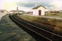 The disused Kilmarnock platforms (looking to Kilmarnock) on the alignment opened by the GPKAR on regauging the Kilmarnock and Troon Railway. The original KTR alignment had almost no curve and was to the right.<br><br>[Ewan Crawford //1989]