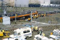 The aftermath of the Bellgrove crash in 1989. Two 303s met in a head on collision on the single lead from Bellgrove Junction. One driver and one passenger were killed. The Springburn bound train is to the left and that from Springburn underneath and to the right. The Airdrie line is in the foreground. [See image 33386]<br><br>[Ewan Crawford 06/03/1989]