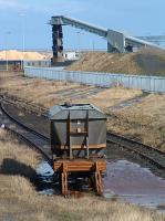 A wagon languishes in the <i>cripples</i> siding at Bates Staithes, Blyth. Given the state of the track from Newsham North Junction behind the camera it was unlikely to move any time soon.<br><br>[Ewan Crawford 20/03/2004]