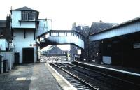 The unique signal box and footbridge arrangement at Broughty Ferry. Photographed in August 1985 looking over the level crossing towards Aberdeen.<br><br>[David Panton 22/08/1985]