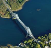 Aerial view of the Connel bridge on 5 October 2008. The bridge was built by Arrols Bridge & Roof Co [see image 18249] to carry the Ballachulish branch of the Callander & Oban Railway over Loch Etive and opened on 20 August 1903. A roadway was added alongside the line in 1914. The Ballachulish branch closed in 1966 and today the bridge carries single file road traffic controlled by traffic lights.<br><br>[Brian Smith 05/10/2008]
