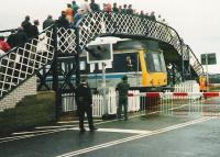 <I>NO, NO!!! ...A SEVEN IRON, A SEVEN IRON....!!!</I> The driver of a <i>Golfers Special</i> DMU is temporarily distracted prior to leaving the platform at Carnoustie for the siding during <I>The Open Golf Championship</I> on 17 July 1999. <br><br>[David Panton 17/07/1999]