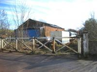 The level crossing gates and goods shed at Appleby East in February 2007. The station is to the right of the picture (towards Warcop). Passenger services were withdrawn in 1962 but freight remained between Appleby and Hartley Quarry until 1974 when it was cut back to Warcop serving the Army camp and training area until 1989. Appleby East yard and station is now the site of a local recycling company although the present Eden Valley Railway hopes to reopen the line from its base at Warcop to Appleby East.<br><br>[John McIntyre 18/02/2007]