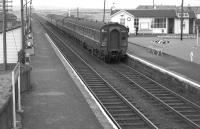 A Glasgow - Ayr DMU arrives at Barassie in August 1963. [See image 30000]<br><br>[Colin Miller 23/08/1963]