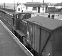 D2437, the Barassie wagon works shunter, out on a foray up the main line prior to propelling its train back into the works yard in the Summer of 1963. [Built by the G&SWR in 1902, the former Barassie carriage and wagon works became a wagon repair facility in 1928 until its eventual closure in 1974.]<br><br>[Colin Miller 23/08/1963]