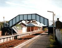 View towards Carlisle from Annan station in October 1997, before demolition of the platform buildings on the right.<br><br>[David Panton /10/1997]