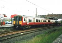 318 257 pulls into Ardrossan South Beach in June 1999 with a Glasgow Central service. <br><br>[David Panton /06/1999]