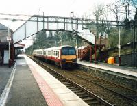 320 316 on a Milngavie service calls at Bearsden in March 1999.<br><br>[David Panton 01/03/1999]