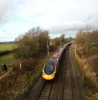 A down Pendolino is seen from a footbridge on the WCML just north of Preston on 24 January 2009. The train is about to pass under the A6 on its journey to Lancaster.<br> <br><br>[John McIntyre 24/01/2009]