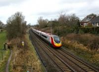 A southbound Pendolino approaches the footbridge alongside the site of Barton & Broughton station, Lancs, on 24 January 2009.<br><br>[John McIntyre 24/01/2009]
