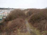 <I>End of the line</I>. The disused former Fleetwood line peters out about one mile north of Burn Naze and this view towards Wyre Dock and Fleetwood shows the last few yards of track, finally used by coal trains to Fleetwood Power Station in the 1980s. Long demolished Fleetwood steam shed was in the middle distance on the left hand side of the line. Photo taken from an overbridge at Map Ref <br> SD 329455. <br><br>[Mark Bartlett 17/02/2009]